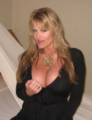 Kelly Madison stripping at home - 01