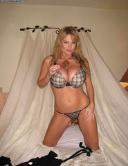 Kelly Madison stripping at home - 03