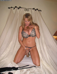 Kelly Madison stripping at home - 04