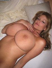 Kelly Madison stripping at home - 13